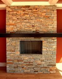 beige stone fireplace mantel with dark brown wooden shelf
