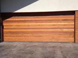 fatezzi faux wood garage doors 46 hold on wood garage doors the elegant look of wood garage