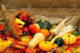 harvest or thanksgiving cornucopia filled with vegetables against
