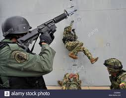 file us navy 101210 n us navy seal team members boarding a ship in combat
