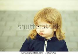 how should an 11year old boys hair look like 11 year old boy glares camera stock photo 127064687 shutterstock