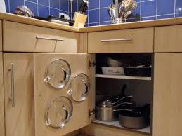 easy kitchen storage ideas pot lids easy to find by hanging them on the cabinet door 12