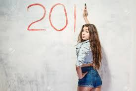 new years shorts girl in shorts and jacket draws a christmas new year stock