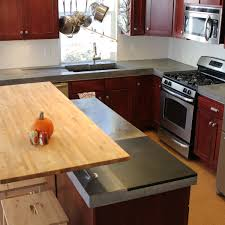Red Mahogany Kitchen Cabinets by Agreeable Brown Color Kitchen Concrete Countertops Features White