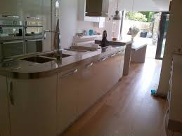 island unit with stainless steel worktop and integral double bowl