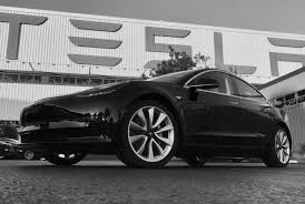 elon musk unveils photos of the first tesla model 3 to roll off