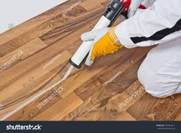 Laminate Flooring Waterproof Sealant Worker Applies Silicone Sealant Spaces Old Stock Photo 109451411
