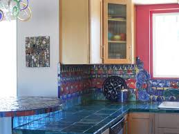 navy blue tile countertop colorful handmade backsplash light brown navy blue tile countertop colorful handmade backsplash light brown wooden cabinets red wall unique pendant lights