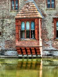window over the moat by saxonfenken oxburgh hall a 15th