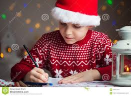 christmas kid write wish list child santa hat writing letter