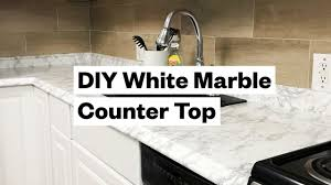 white kitchen cabinets with marble counters transform your kitchen for 20 diy white marble countertop