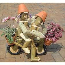 wooden garden flowerpot man on a motorbike