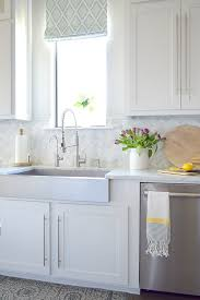 how high cabinet above sink kitchen backsplash tile how high to go driven by decor