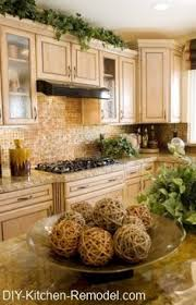 Decorating The Top Of Kitchen Cabinets by Tips For Decorating Above Kitchen Cabinets This Is Laid Out Just