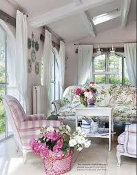 pretty living room with floral scheme and pink white armchair plus
