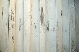 white painted wooden panel wall with chipping paint stock photo
