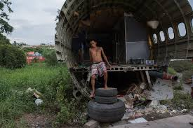 bangkok aeroplane graveyard becomes an unlikely home for