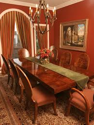 this bold dining room features rust colored walls and rust olive
