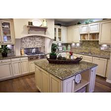 the dark granite is nice with the pickled cabinets remodel