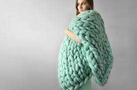these giant knitted blankets are the answer to your winter prayers