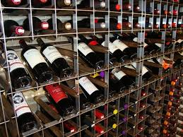 floor to ceiling style wine racks with tilt display retail wine