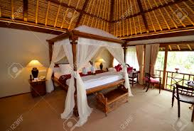 bali hotel spa bedroom with four poster bed and mosquito nets bali hotel spa bedroom with four poster bed and mosquito nets stock photo 31750272
