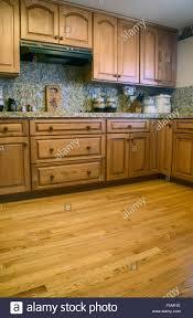 oak kitchen cabinets and granite countertops kitchen with oak cabinets wood floor and granite