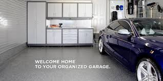 garage flooring storage organization garage living blue audi in a two car garage with white cabinets