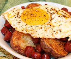 basque in a spanish breakfast huevos rotos con chistorra y