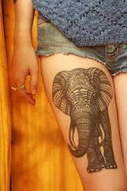 tribal elephant tattoo on side thigh real photo pictures images