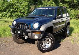 2006 green jeep liberty all liberty models have the jeep trail rated badge thus ensuring