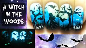 a witch in the woods halloween glow in the dark freehand nail