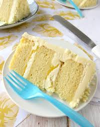 the food dash lemon layer cake with white chocolate frosting