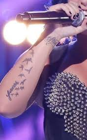 demi lovato u0027s string of birds tattoo on her arm tattoo tatting