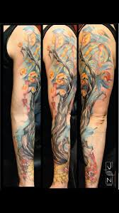 unique watercolor tattoo tree with lanterns by justin nordine