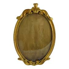 antique nouveau gilt brass frame oval from ornaments on ruby