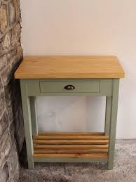 new edition crickhowell butcher s block kitchen island powell the butcher s block has been finished using an antique pine wax and a willow green paint which creates a rustic yet elegant touch