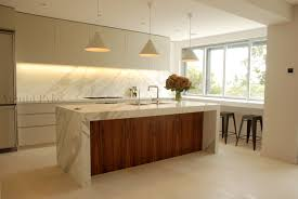 natural stone island bench light and simplistic kitchen dining