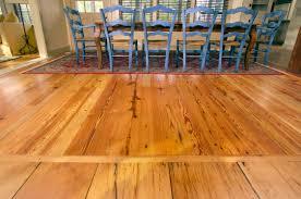 reclaimed heart pine floors in dining room