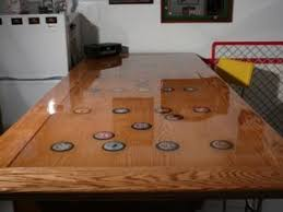 how to protect wood table top picture of product 214 resin on a table top this can be applied to