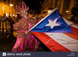 a costumed reveler called vejigante dances in the street with a