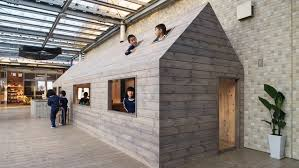 small house in hibinosekkei installs micro house in japanese kindergarten to
