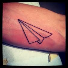 symetric paper plane tattoo tattoomagz