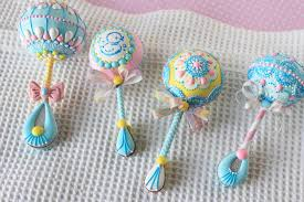 baby rattle cake pops how to make 3 d baby rattle cookies with a gender reveal