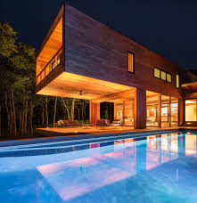 elevated cabin boasts modern design balance associates