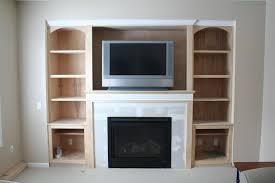 simple entertainment center around fireplace excellent home design