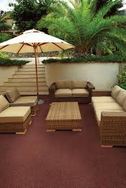 simple deck patio design with maroon color outdoor rugs and