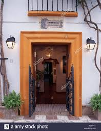 Front Door Security Gate by Wrought Iron Security Gates On Open Front Door Of Spanish Villa