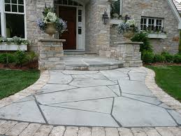 grey stone floor patio with green grass yard also green plant on