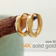 s mens earrings these solid gold medium hoop earrings for men are slightly domed